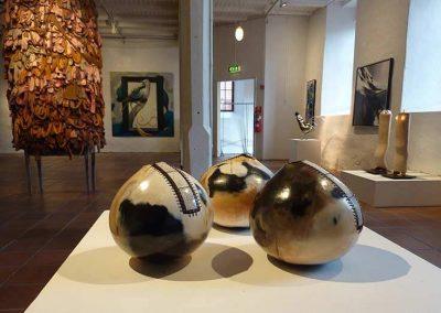 Three Glossy Black Oval-shaped Ceramic Pieces