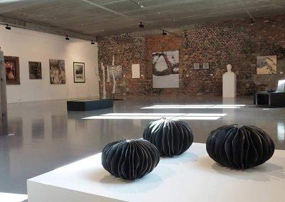 Three Black Ceramic Pieces Shaped With Seaweed