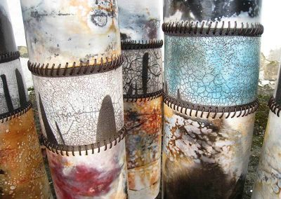 Three Ceramic Piece Tall As A Cylinder, Of Various Colors