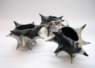 Three Ceramic Pieces Of Black And Smoky Gray Color
